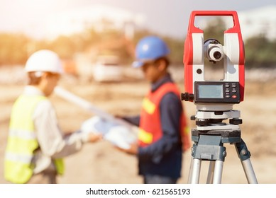 Civil Engineers At Construction Site and A land surveyor using an altometer by asia man.