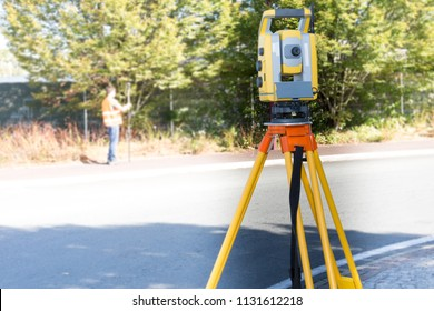 Civil Engineers At Construction Site using an altometer Surveyor equipment tacheometer outdoors