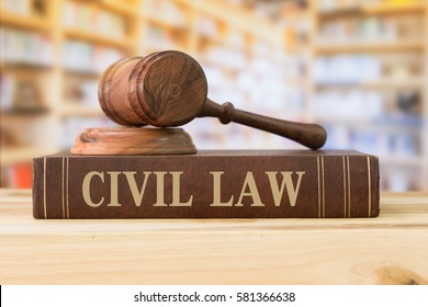 civil law books and a gavel on desk in the library. concept of legal education.