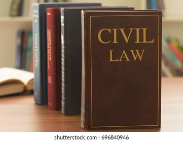 civil law books on desk in the law library. legal education jurisprudence concept.
