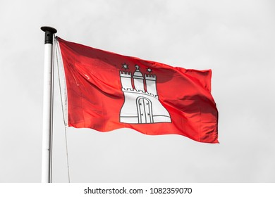Civil and state flag of the Free and Hanseatic City of Hamburg, with the coat of arms showing a white castle with three towers on a red background (Gules, a castle triple-turreted Argent)