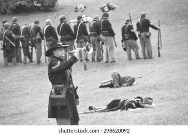 CIVIL WAR BATTLE RE-ENACTMENT, PORT GAMBLE, WA - 20 JUN 2009 -  Union bugler playing taps after  the battle