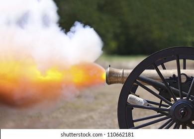 Civil War cannon firing at a civil war re-enactment.