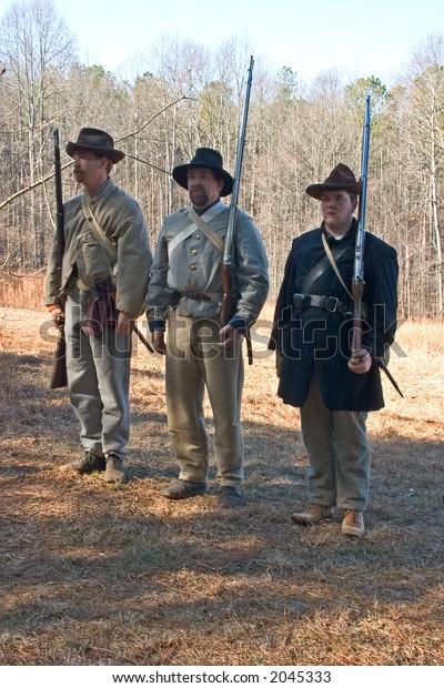 Civil War Rebel Re-Enactors Stand at Attention