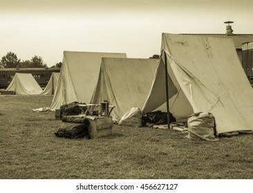 Civil War Reenactment  Encampment With Railroad Car & Buildings In Background