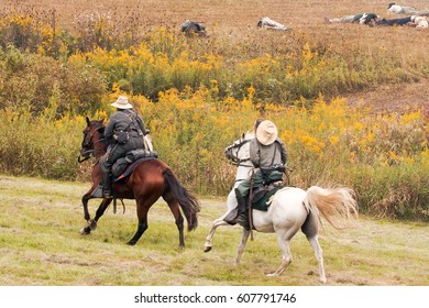 Civil War  re-enactment two horses with confederate soldiers and wounded soldiers