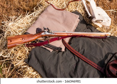 Civil War rifle laying on a bedroll
