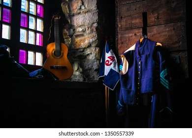 Civil war uniform, with flag, guitar and stained glass windows