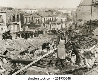 Civilians in Madrid search through the rubble of their homes in 'Liberated Madrid'. The Nationalists finally captured the besieged city on March 28, 1939. Spanish Civil War, July 1936-March 1939.