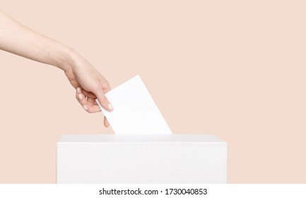 Civilized Equal Rights Concept. Female Hand Lowers Ballot In Ballot Box On Light Suntan Peach Background