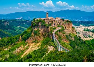Civita di Bagnoregio, Lazio / Italy - 2018/05/26: Panoramic view of historic town of Civita di Bagnoregio with surrounding hills and valleys of Lazio region