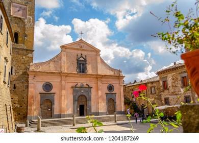 CIVITA DI BAGNOREGIO, VITERBO, LAZIO, ITALY - October 1, 2018: Chiesa di San Donato, with a Romanesque structure and bell tower has two Etruscan sarcophagi at its base.