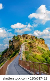 """CIVITA DI BAGNOREGIO, VITERBO, LAZIO, ITALY - October 1, 2018: Medieval village, that stands in the valley of the calanchi, called """"The dying city"""" due to geological instability."""