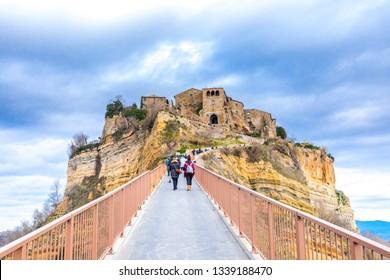 """Civita di Bagnoregio, Viterbo, Lazio, Italy: the """"dying city"""" picturesque landscape of the ancient village on the steep tuff hill."""