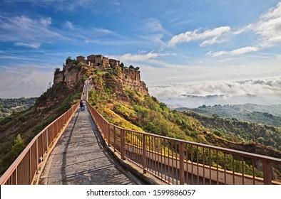 Civita di Bagnoregio, Viterbo, Lazio, Italy: picturesque landscape at sunrise of the ancient village on the steep tuff hill