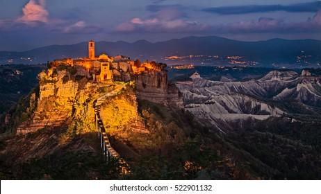 Civita di Bagnoregio, Viterbo, Lazio, Italy: picturesque landscape at twilight of the ancient village on the steep tuff hill