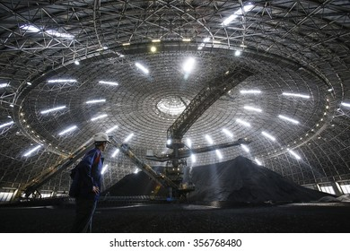 CIVITAVECCHIA, ITALY - 10 OCTOBER 2014: Coal sitting inside the sealed storage dome at a thermoelectric coal-fired power station.
