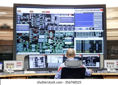 CIVITAVECCHIA, ITALY - 10 OCTOBER 2014: Employees monitoring operational data on computer monitors as they work in the control room at a thermoelectric coal-fired power station.