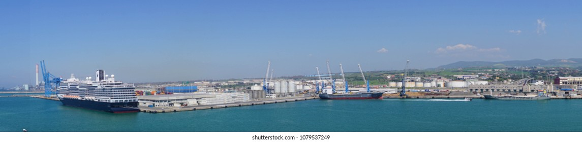 CIVITAVECCHIA, ITALY - APR 21, 2018 - Panorama of cruise ship and working container harbor of Civitavecchia, Italy