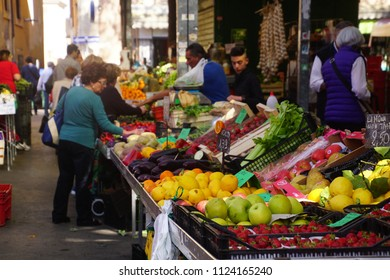 CIVITAVECCHIA, ITALY - APR 21, 2018 - Buying fruit and vegetables at the central Market in Civitavecchia, Italy