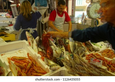 CIVITAVECCHIA, ITALY - APR 21, 2018 - Selling fish in the covered market of Civitavecchia, Italy