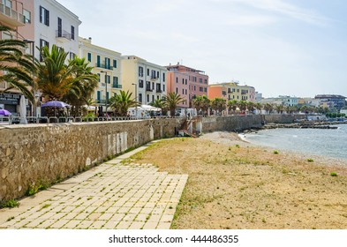 Civitavecchia, Italy - May 28, 2016: A view of Civitavecchia, a major cruise and ferry port, showing a beach and the coastal street Lungomare Ammiraglio Thaon De Revel with its colorful buildings.