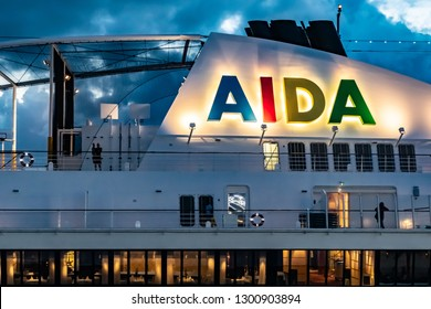 Civitavecchia, Italy - November 5, 2018: Close up on the AIDA logo on the Aida Sol (AIDAsol) Cruise Ship and a view throught the windows of a restaurant onboard.