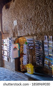 Civita(VT)Italy-November 19,2020:Souvenir shop, stay in front of pathway inside Civita di Bagnoregio town.In this shop have  many postcard , T-shirts and Refrigerator magnet attached.