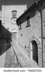 Civitella del Tronto (Teramo, Abruzzi, Italy), medieval town: facade of historic church. Black and white