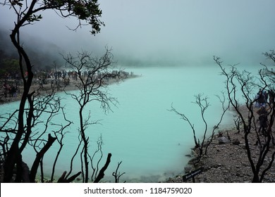 Ciwidey , Bandung , Indonesia - September 2018 : Kawah Putih, translated as `White Crater`, is a sulfur lake set in volcanic crater in the mountain area of Ciwidey near Bandung, Indonesia.