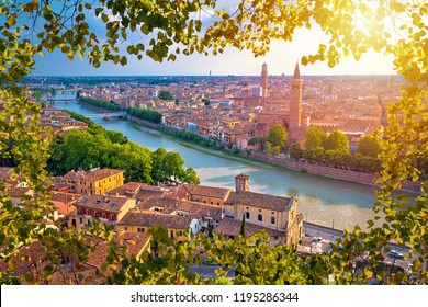 Ciy of Verona and Adige river aerial view through leaf frame, tourist destination in Veneto region of Italy