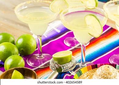 Claasic lime margarita with garnish lime and turbinado sugar for Fiesta.