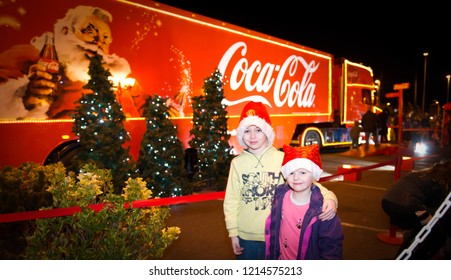 Clacton on Sea, Essex - 20th December 2017 - A little boy with ADHD, Autism, Aspergers Syndrome and sister pose with the world famous Coca Cola, CocaCola Christmas truck, lorry on view for all to see