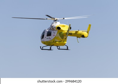 Clacton-on-sea, Essex, England, UK: 1 August 2013- Helicopter rescue, Yellow helicopter in the air while flying on blue sky, on its way to rescue someone.