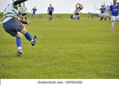 Claddagh, Galway, Ireland june 2017 , Man executing a cross from a free kick in the free public soccer field, as part of the Interfirm cup.