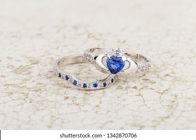 Claddagh ring with blue topaz. Traditional Irish ring in shape of two hands holding a heart shaped blue gemstone which represents love, loyalty, and friendship
