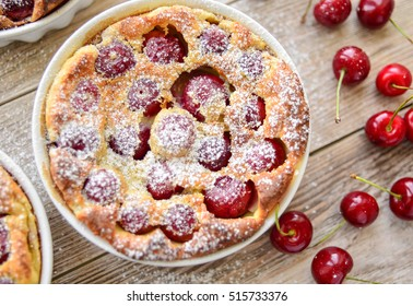 Clafoutis with cherry in ceramic form - French tart with cherry