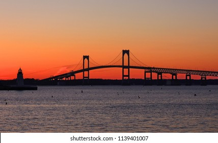 the claiborne pell newport bridge from jamestown to newport,  rhode island, over narragansett bay, with a spectacular sunset