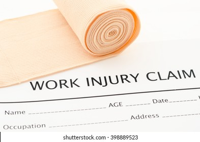 Claim form for an injury at work with medical bandage.
