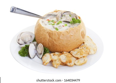 Clam chowder soup in bread bowl isolated on a white background.