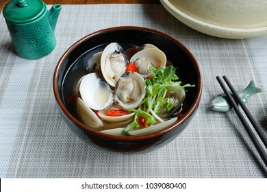 clam Miso soup or Asari Miso soup ,japanese simple style cooking ,broth asari  clam soup sprinkle with chopped chilli and pea sprout  /japanese food