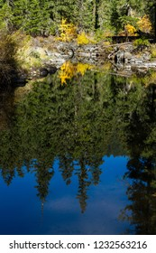 Clam section of the Rouge River in southern Oregon with a beautiful reflection and a little bit of color in autumn