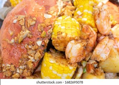 Clambake with clams, garlic, shirmp, crab - whole crab shell - tray food