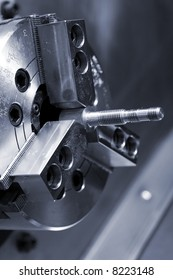 The clamped screw in a cartridge of a lathe