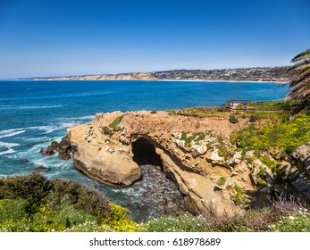 Clam's Cave on Goldfish point, La Jolla, California. Cliffs of Torrey Pines are in the distance