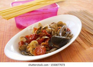 sautè of clams and mussels in a serving dish