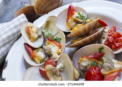 Clams  with napkin and tomatoes