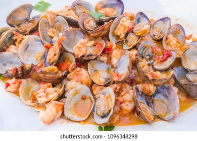 clams and prawns in a tomato sauce with peppers and garlic