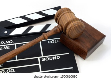 A clapboard and gavel for concepts related to movie production laws and regulations.