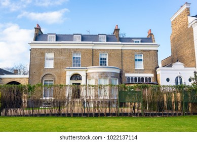 Clapham London, UK - January 2018: Facade of an opulent restored Victorian house luxury mansion in yellow bricks and white finishing with private garden in Clapham, South London, UK.